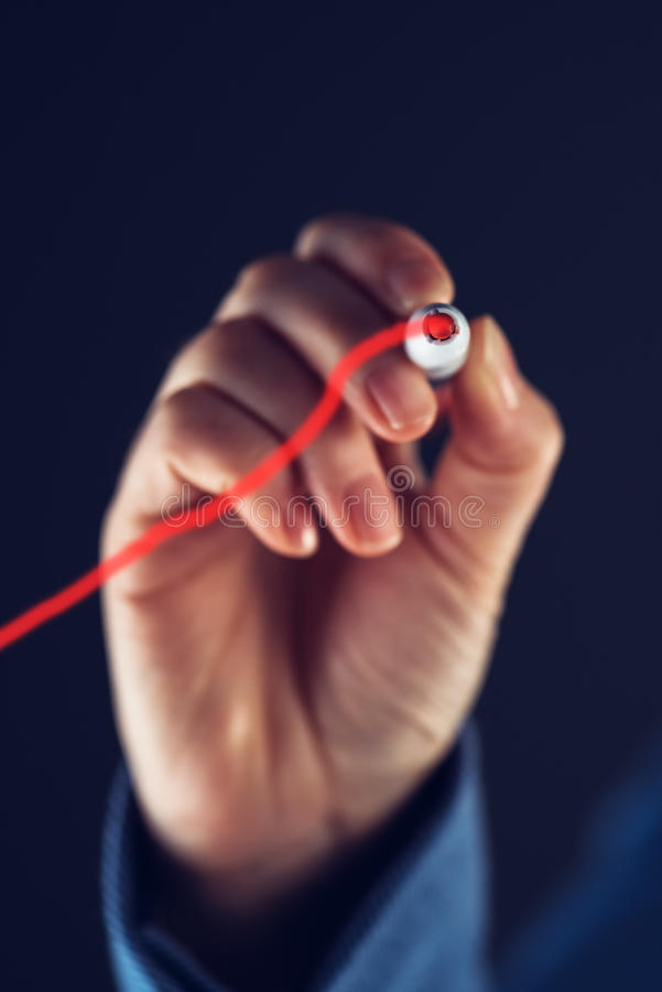 Businesswoman drawing business growth graph royalty free stock photo