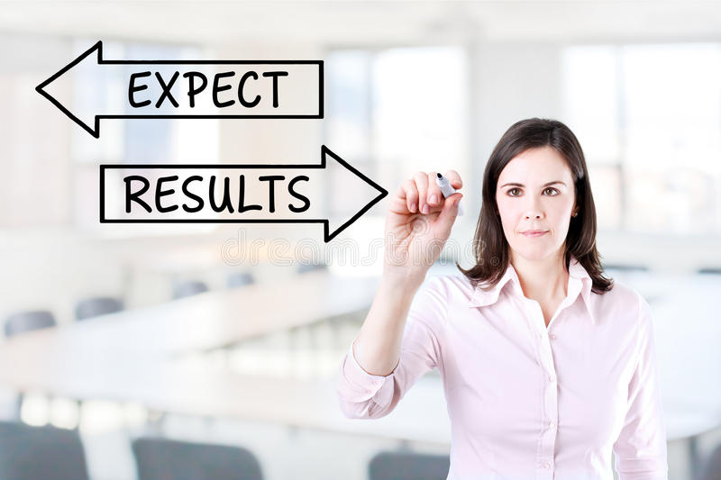 Businesswoman drawing a Results and Expectations concept on the virtual screen. Office background. stock photo