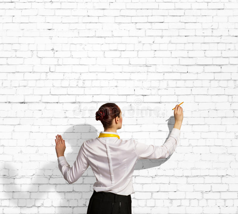 Download Businesswoman Drawing On Wall Stock Photo - Image: 33194340