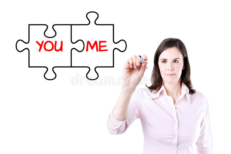 Businesswoman drawing a You and Me puzzle love concept on the virtual screen. Businesswoman drawing a You and Me puzzle love concept on the virtual screen royalty free stock image