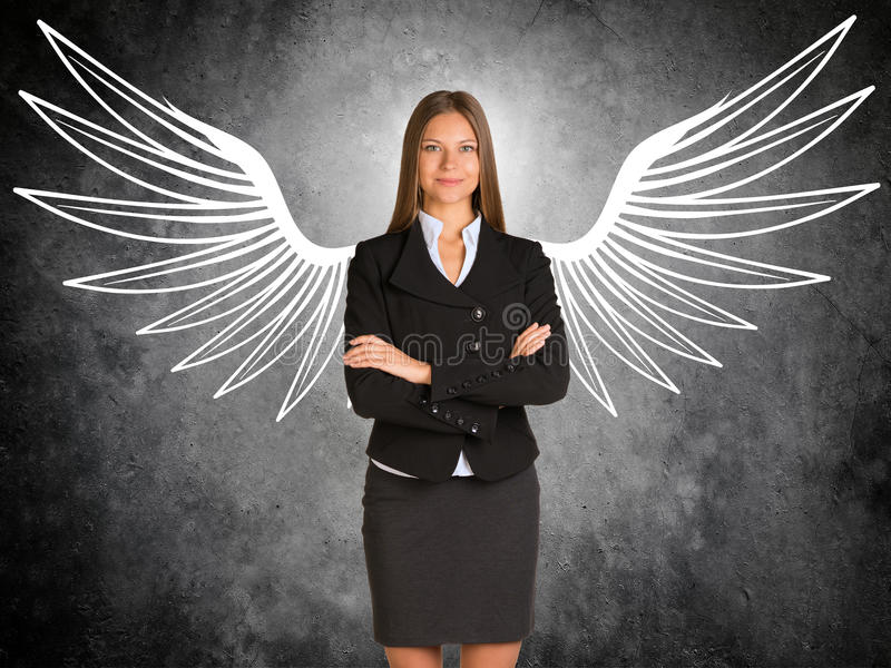 Businesswoman with drawn angel wings royalty free stock images