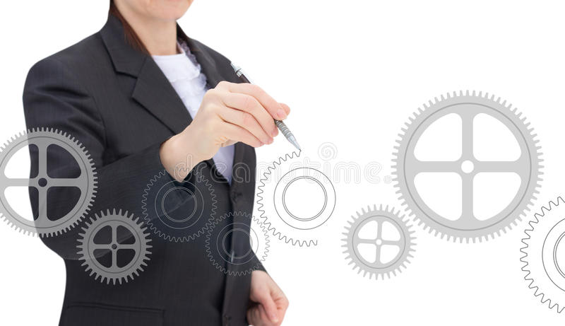 Businesswoman draws gears. stock images