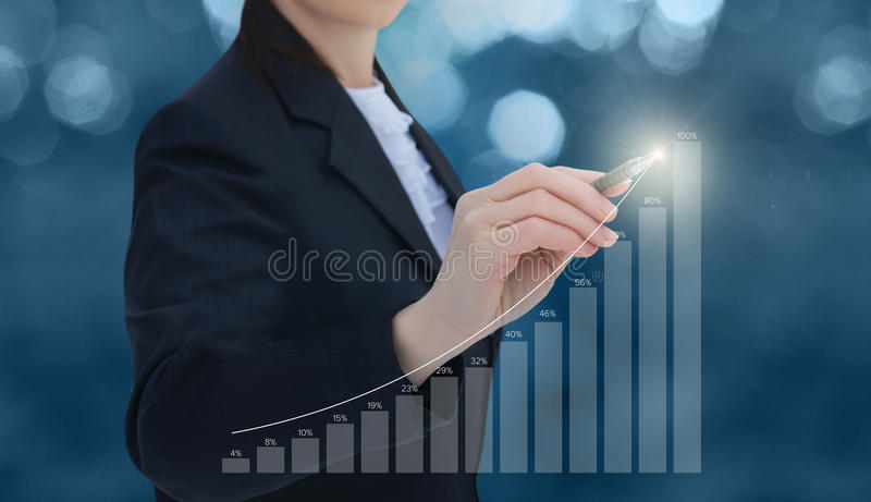 Businesswoman draws a graph of statistics. royalty free stock photo