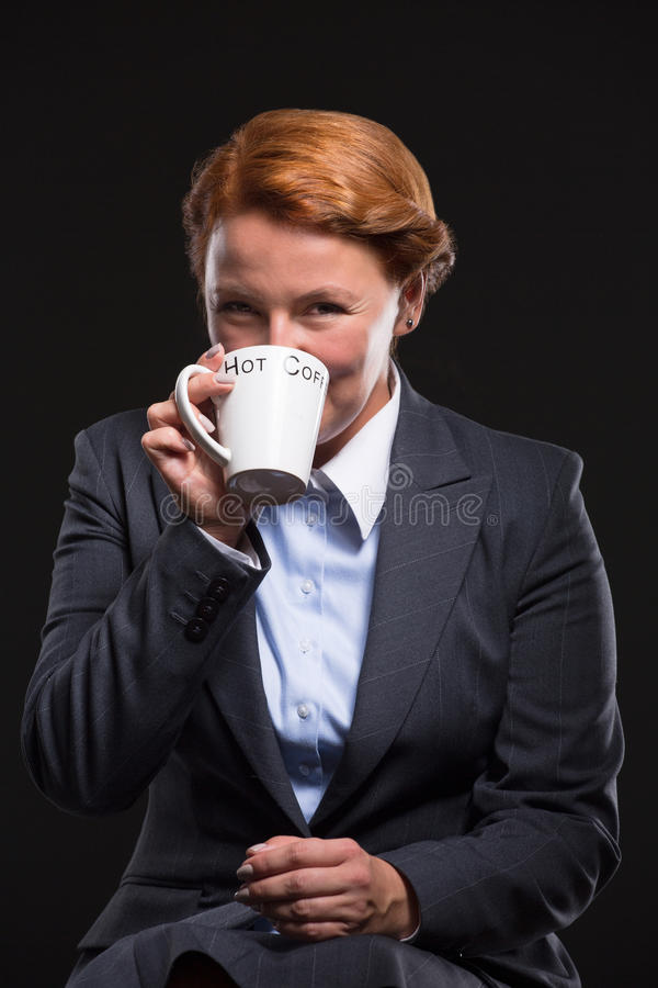 Businesswoman drinking coffee royalty free stock photography