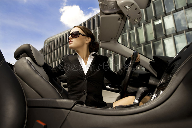 Businesswoman driving a car stock images
