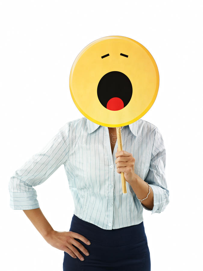 Businesswoman with emoticon stock photography