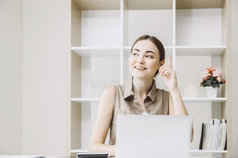Businesswoman employee remember or thinking about good new project of idea royalty free stock images