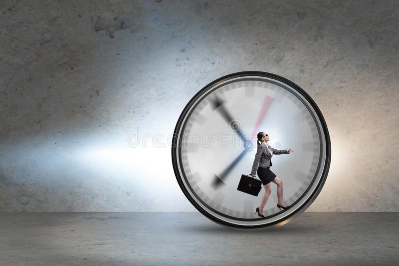 Businesswoman employee in time management concept. The businesswoman employee in time management concept stock photo