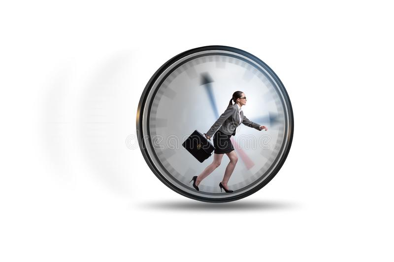 Businesswoman employee in time management concept. The businesswoman employee in time management concept stock image