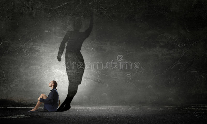 Businesswoman in empty room . Mixed media stock images