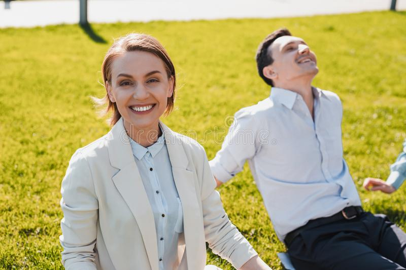 Businesswoman enjoying sunny weather out of office royalty free stock photo