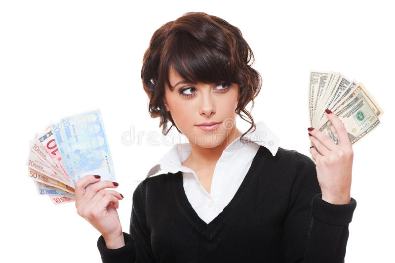 Businesswoman With Euro And Dollar Money Notes Stock Photo