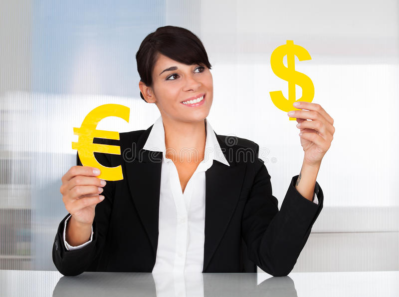 Download Businesswoman With Euro And Dollar Sign Stock Photo - Image: 34957232