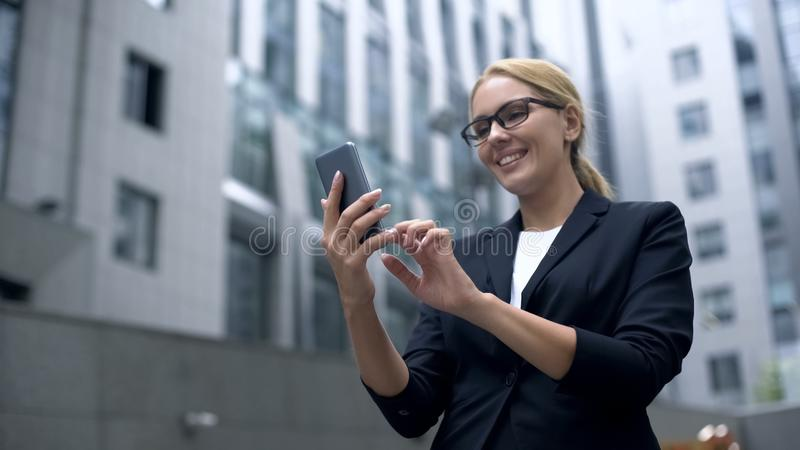 Businesswoman excited with convenient app in smartphone, electronic organizer. Stock photo royalty free stock photo