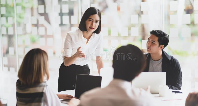 Businesswoman explaining her strategy to her team members stock photography
