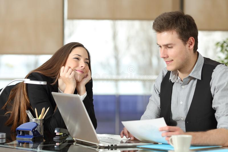 Businesswoman falling in love with a colleague stock photos
