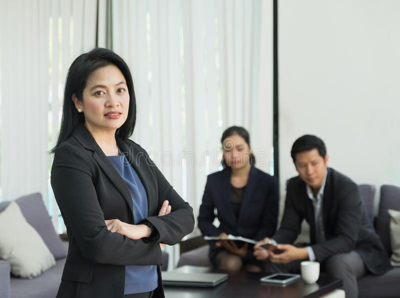 Businesswoman female leader standing and cross arm with team in. Corporate meeting at office,Female leadership concept stock photos