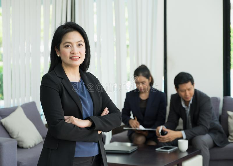 Businesswoman female leader standing and cross arm with team in royalty free stock images