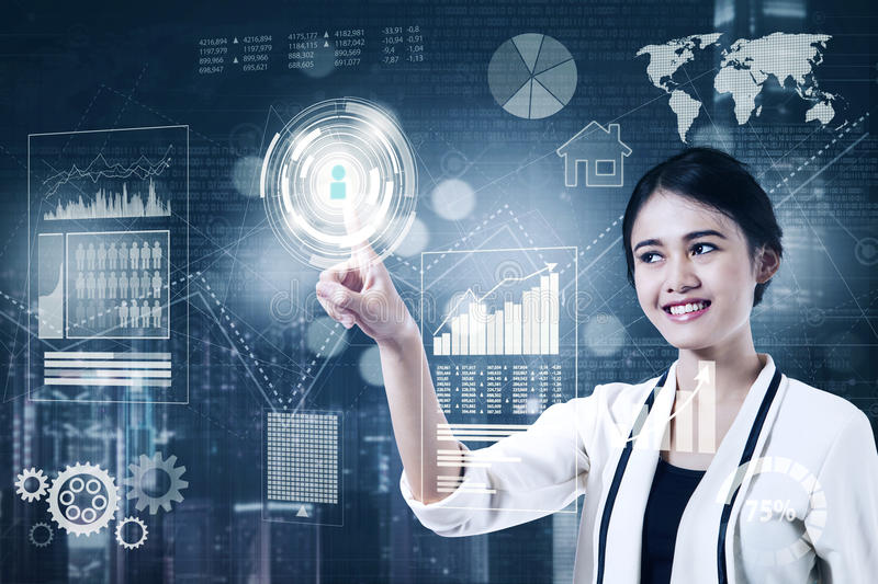 Businesswoman with financial growth on virtual screen. Beautiful businesswoman is touching an icon button with business financial on the virtual screen stock images