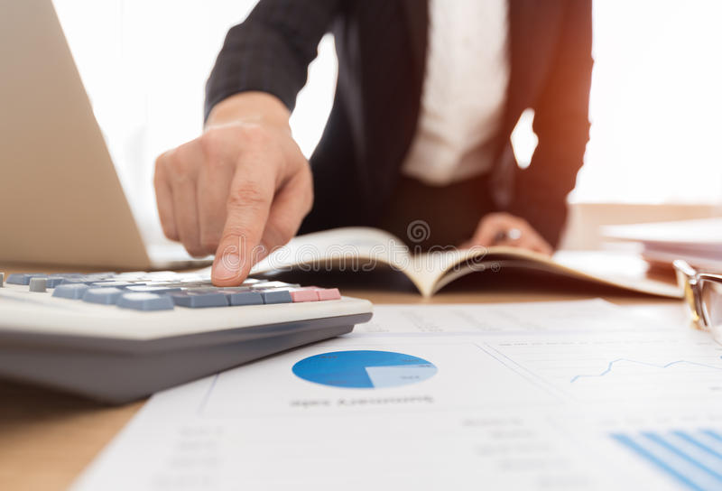 businesswoman financial reports working arkivbilder