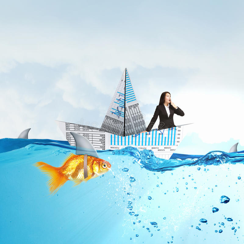 Businesswoman floating in paper ship . Mixed media stock photo