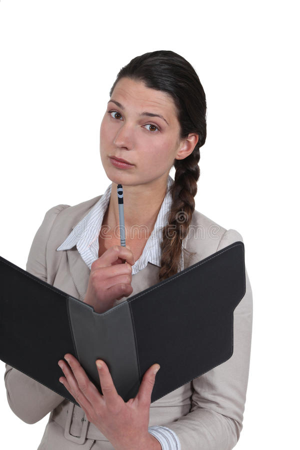 Businesswoman with a folder stock image