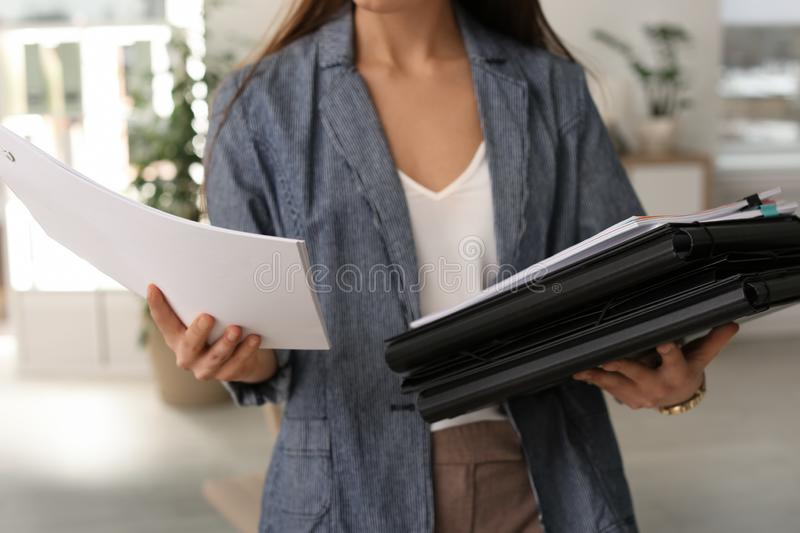 Businesswoman with folders and documents, closeup royalty free stock photos
