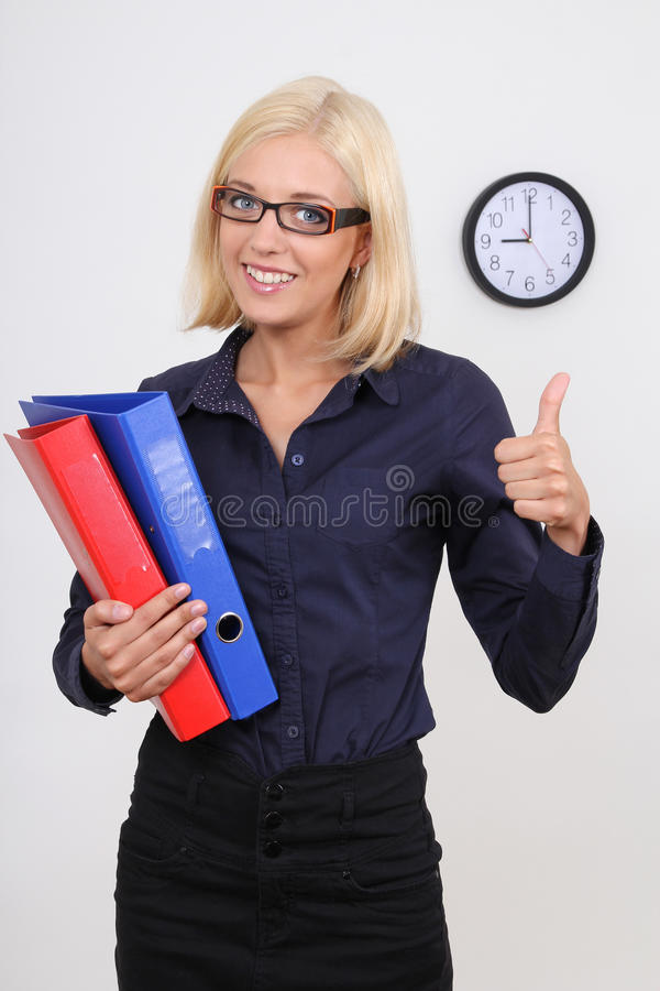 Businesswoman with folders thumbs up. Young succesful businesswoman with folders thumbs up stock images