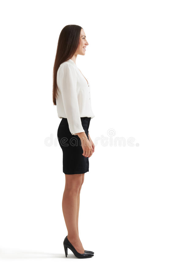 Businesswoman in formal wear. Full-length sideview portrait of businesswoman in formal wear. isolated on white background stock photos