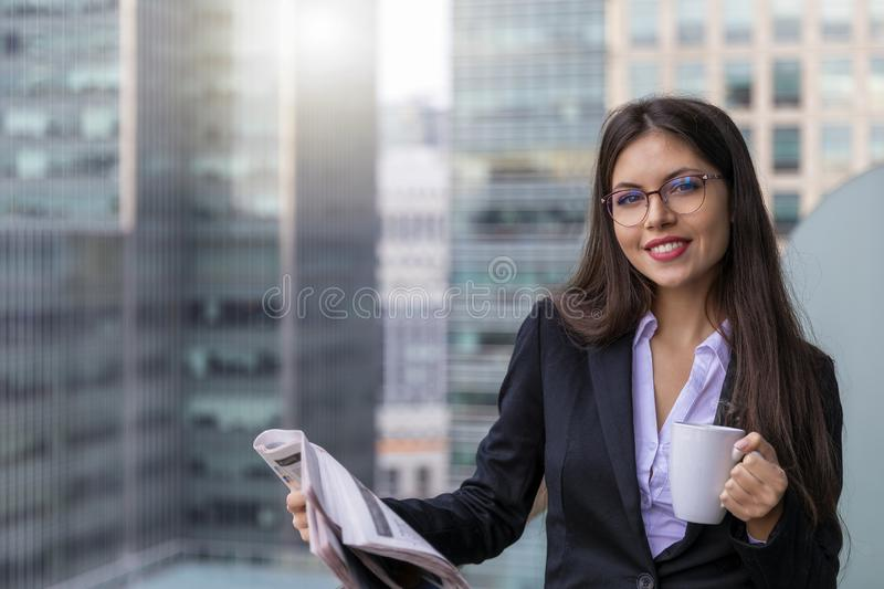Businesswoman in front of modern office buildings stock image
