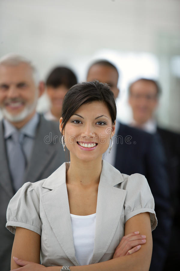 Businesswoman in front of sales team royalty free stock photography