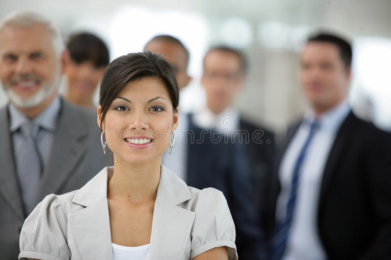 Businesswoman in front of sales team royalty free stock photo