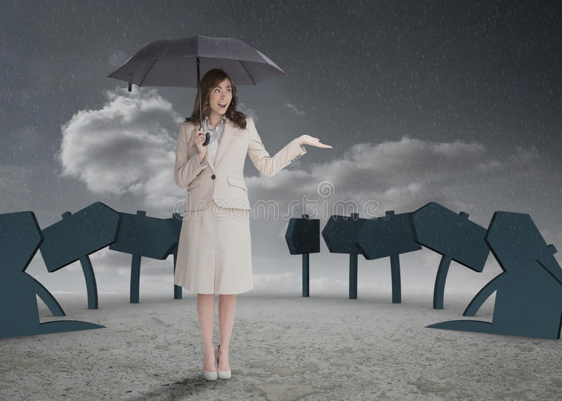 Businesswoman in front of signs. Holding her umbrella and smiling stock images