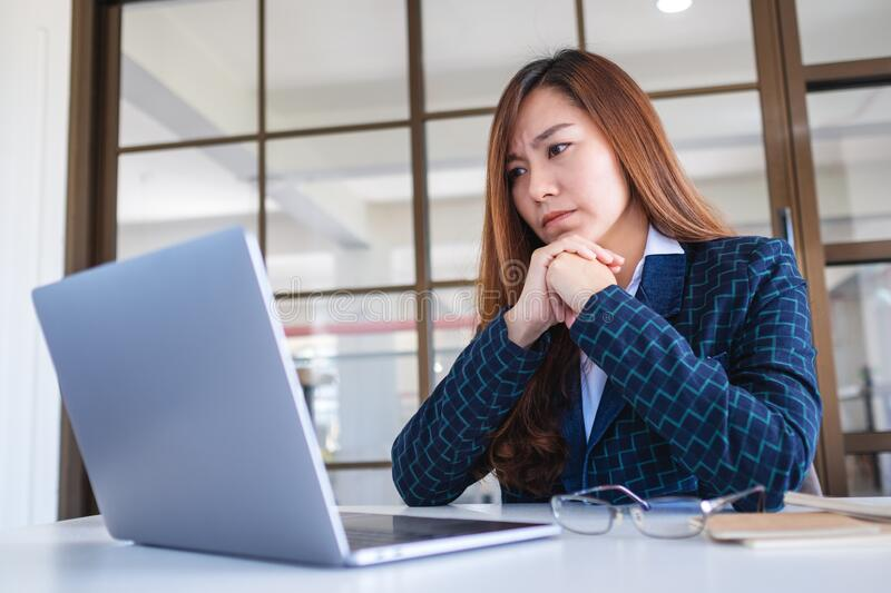 Businesswoman get stressed while working on laptop computer royalty free stock photo