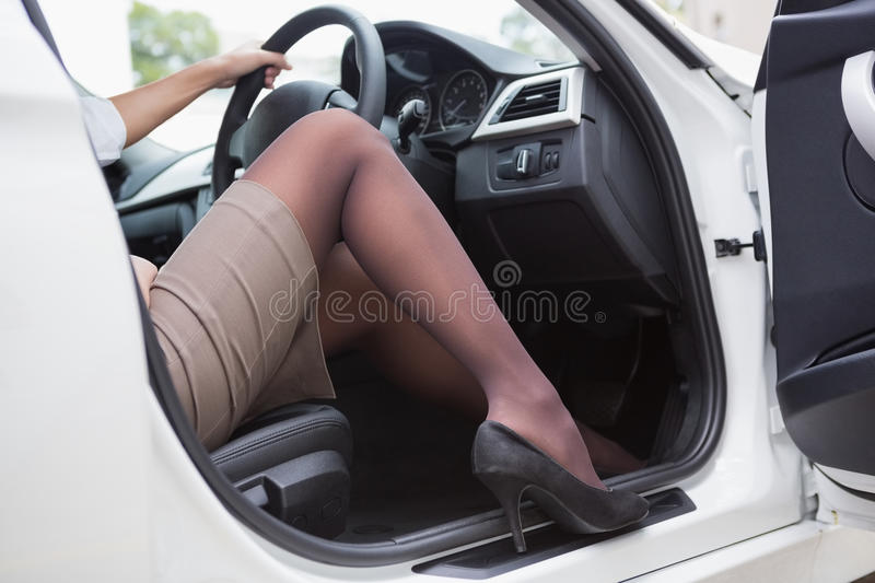 Businesswoman getting out the front door royalty free stock photo