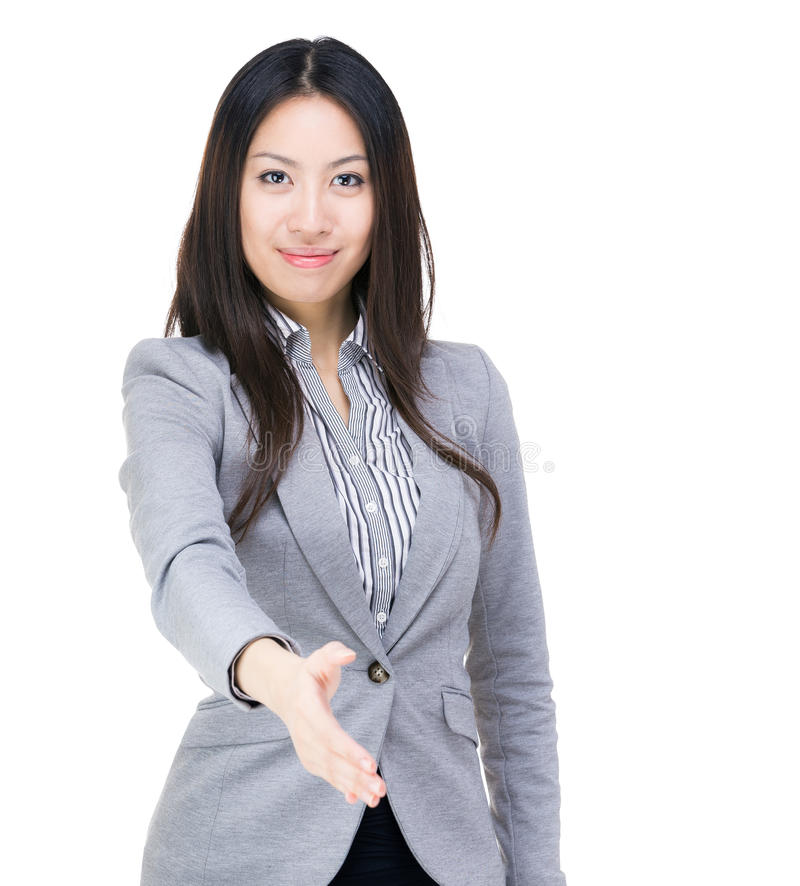 Businesswoman give hand for hand shake. Isolated on white royalty free stock photography