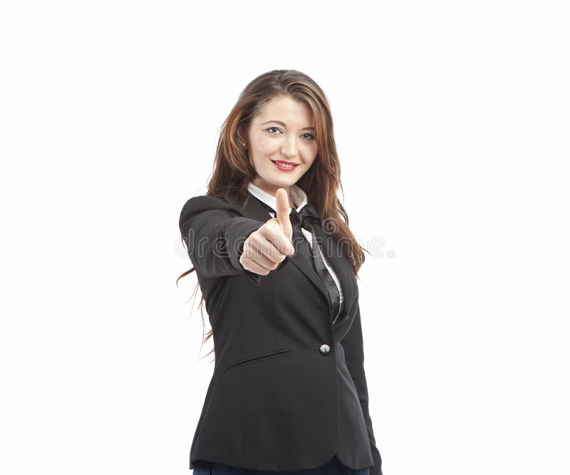 Businesswoman gives thumbs up sign royalty free stock images