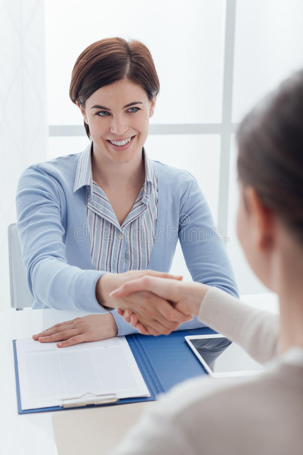 Businesswoman giving an handshake royalty free stock photo