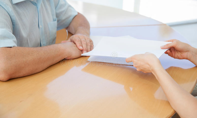 Businesswoman giving to businessman documents for subscription stock images
