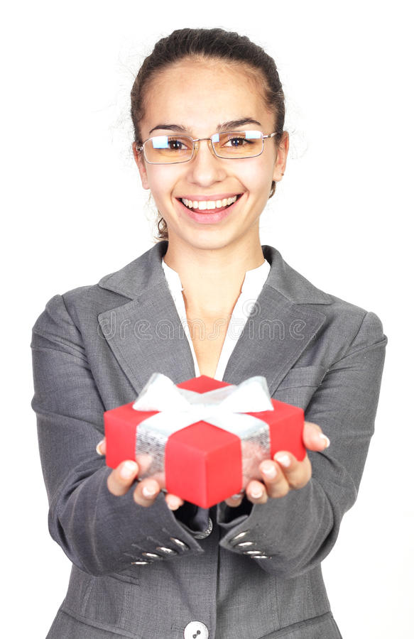 Businesswoman Giving You A Gift Stock Photo