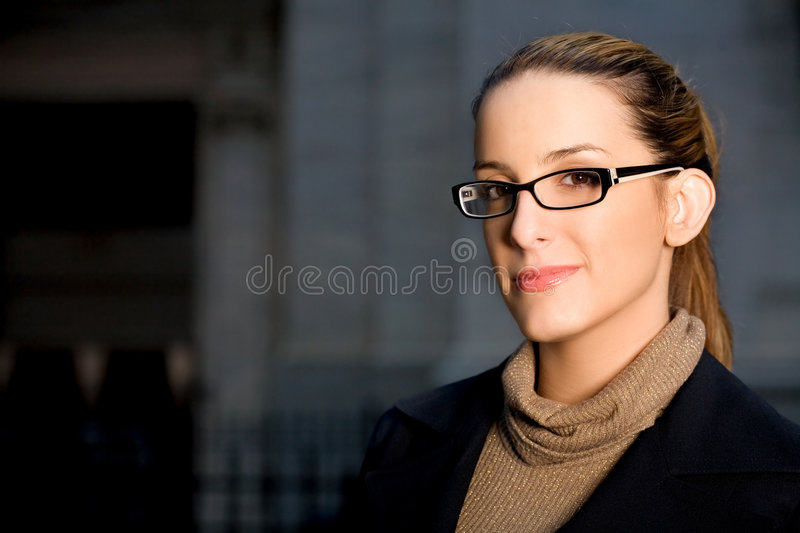 Businesswoman with Glasses. Horizontal Portrait of a Confident Businesswoman Wearing Glasses in the City royalty free stock photography