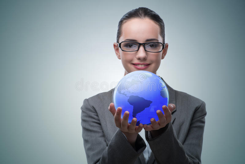 The businesswoman in global business concept stock photography