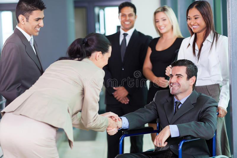 Businesswoman greeting partner royalty free stock photo