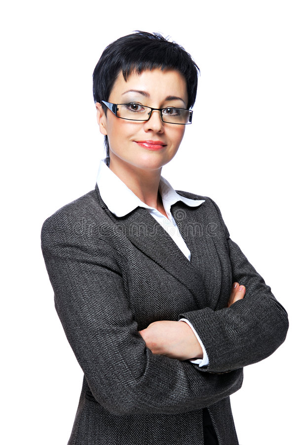 Businesswoman in grey business suit. Mid adult businesswoman in grey business suit with crossed-arms royalty free stock photos