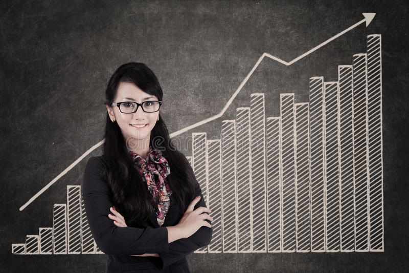 Businesswoman And Growing Bar Chart Stock Photos