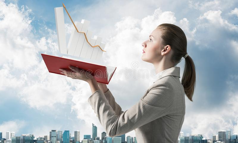 Businesswoman with growing financial graph stock images