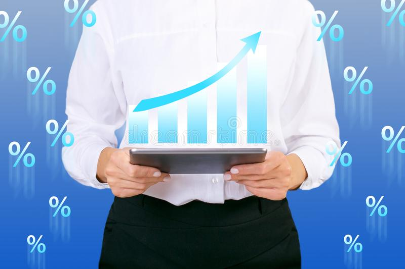 Businesswoman with Growth Chart in high interest concept stock photo