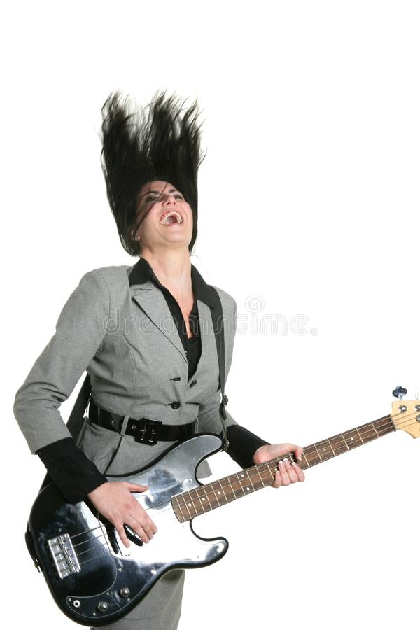 Businesswoman guitar player suit and rock royalty free stock image