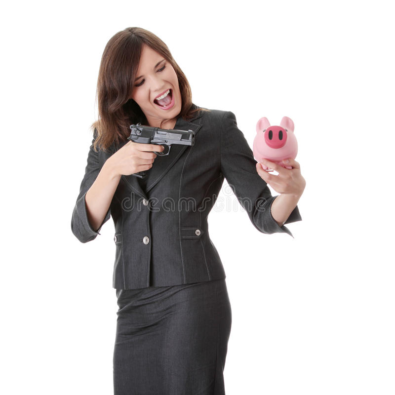 Businesswoman With Gun Pointing At Piggy Bank Stock Image