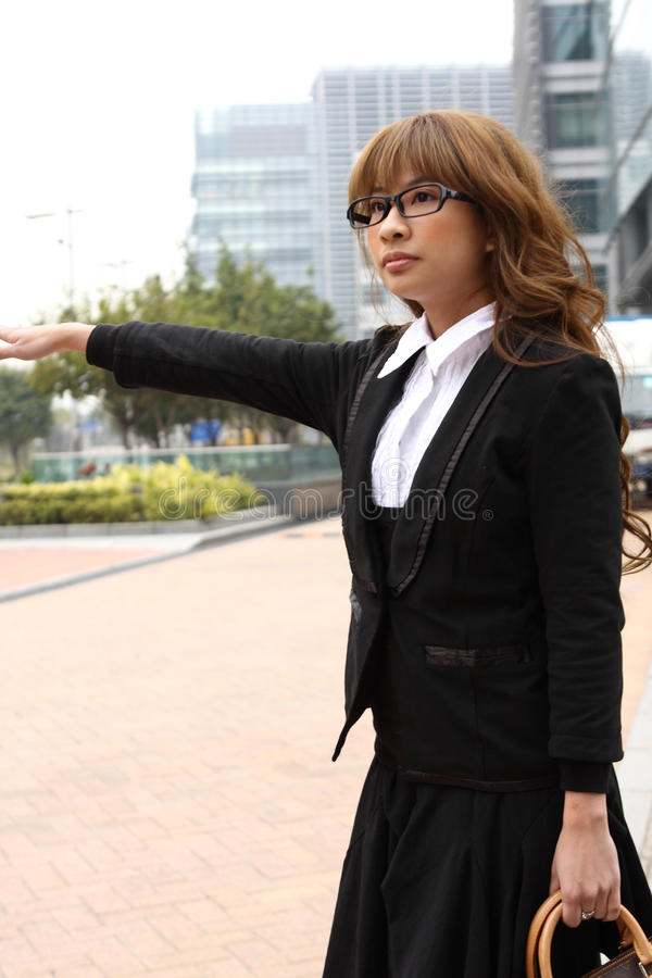 Download Businesswoman hailing taxi stock photo. Image of gesturing - 18783936